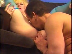 busty older golden-haired in thigh-highs kneels