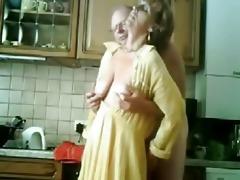 mum and daddy having enjoyment in the kichen.