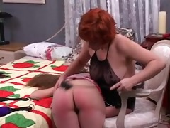 cute lesbian floozy mistress spanks the hell out