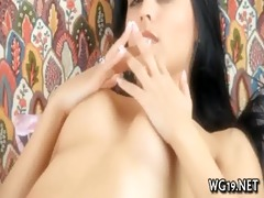 angel plays with sex-toy